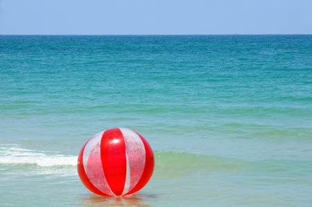 sea sports: floating red ball at mediterranean sea