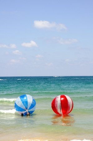 floating red and blue balls at mediterranean sea photo
