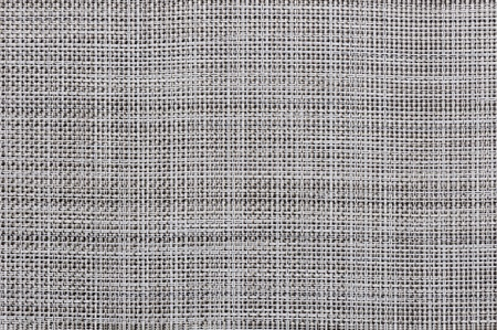 woven surface: grey braided napkin, decorated background Stock Photo