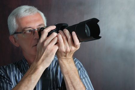 considerable: adult man with photo camera