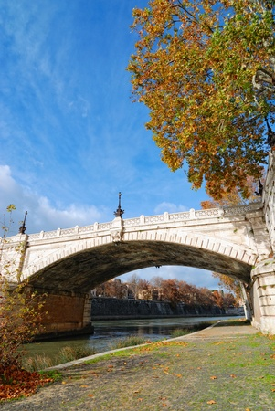 ancient bridge on the Tiber river, Rome, Italy photo
