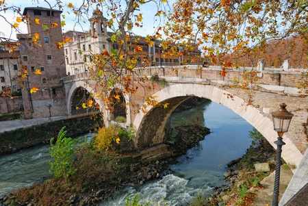 ancient bridge (Ponte Fabricio) on the Tiber river, Rome, Italy Stock Photo - 11789684