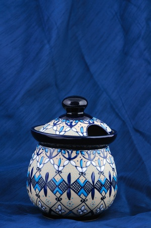 flaws: Colorful traditional Mexican clay pot on a blue fabric