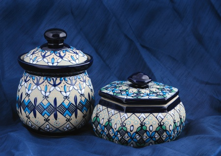 flaws: Colorful traditional Mexican clay pots on a blue fabric Stock Photo