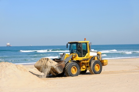 bulldozer working on a beach Stock Photo - 12805752