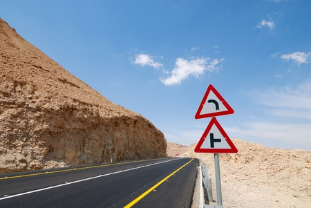 Triangle traffic sign on the highway to the Dead Sea. photo