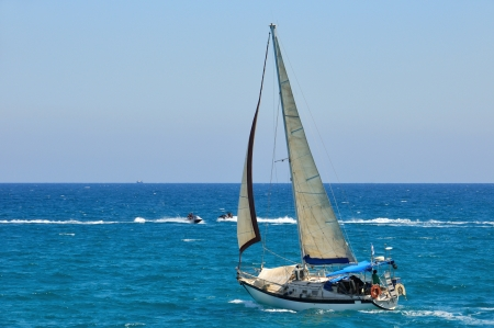 beautiful sailboat sailing in Mediterranean sea near Israel photo