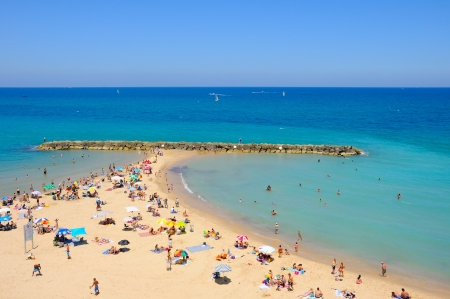 People on the beach in summer in Ashqelon, Israel