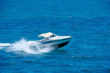 Motorboat on the route on mediterranean sea photo
