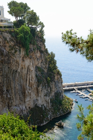 view of sea and rock in Monte Carlo, Monaco photo