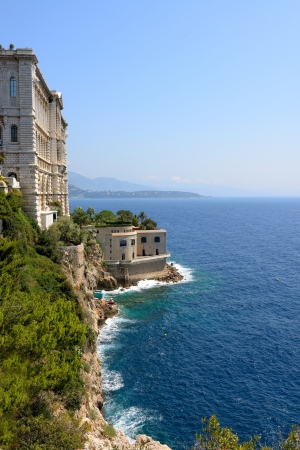 Monaco coast. Ancient buildings and blue sea. photo