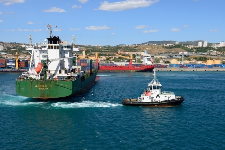MARSEILLE, FRANCE- 15 JULY: Tug boat assists cargo ship Aggeliki P. on July 15,2012 in Marseille, France.  This port is number one in France and the Mediterranean and number three in Europe.