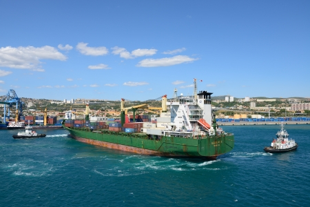 MARSEILLE, FRANCE- 15 JULY: Tug boats assist cargo ship Aggeliki P. on July 15,2012 in Marseille, France.  This port is number one in France and the Mediterranean and number three in Europe