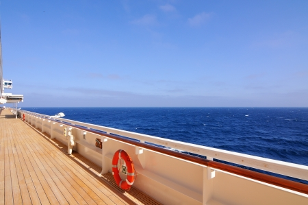 Red lifebuoy on a railing of cruise ship