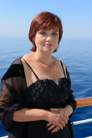 portrait of adult beautiful woman on the ship deck