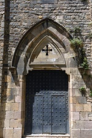 Old metal door of a church in Barcelona photo