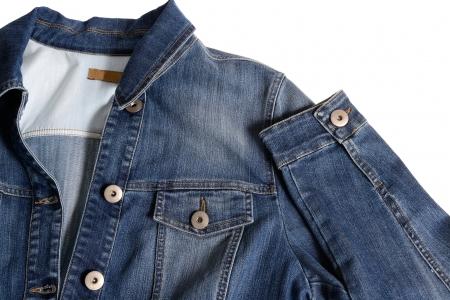 closeup detail of vintage denim jacket over white Stock Photo