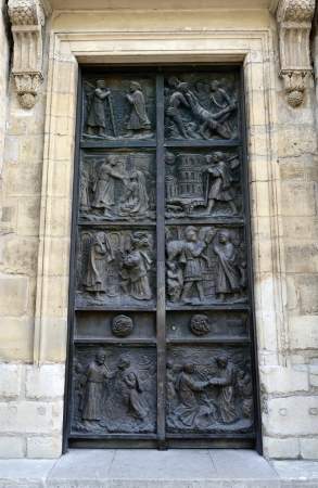 bass relief: Ornate door to the medieval church in Paris. Stock Photo