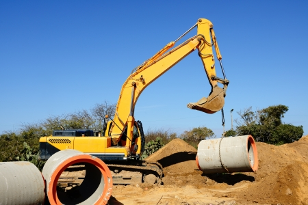 Bulldozer on the build site of  canalization Stock Photo