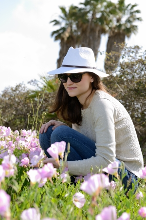 portrait of young woman with white hat outdoors