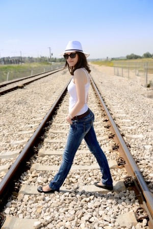 portrait of young woman in white hat outdoors photo