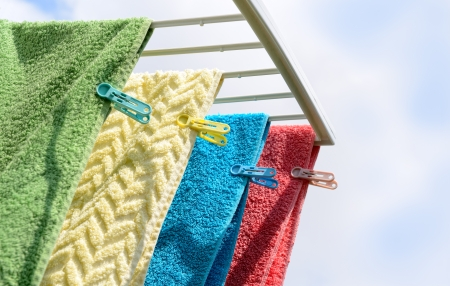 Dry various color towel on clothes dryer Stock Photo