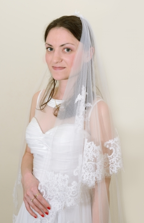 beautiful bride with a white veil photo