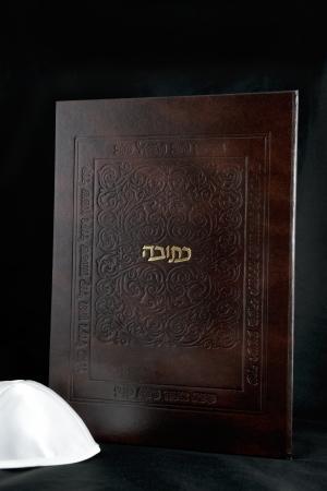 jewish wedding contract  ketubah  on a black background photo