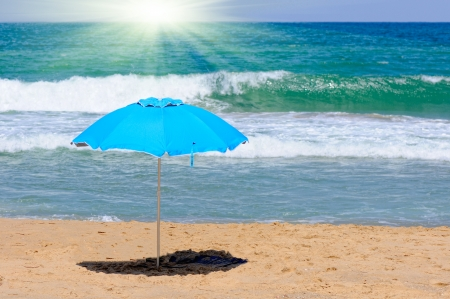 blue umbrella on a beach photo
