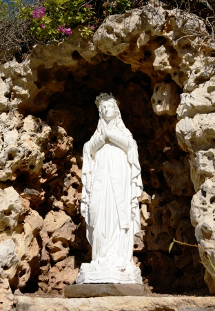 white stone statue of Virgin Mary