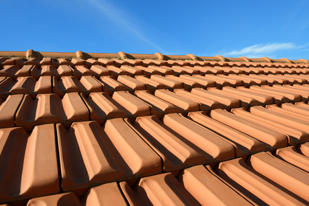 terracotta roof texture tile and blue sky  in background