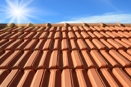 terracotta roof texture tile and blue sky  in background photo