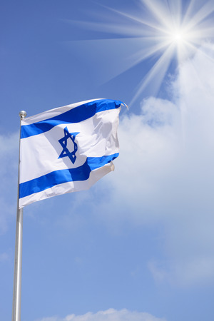 flag of Israel over blue sky photo