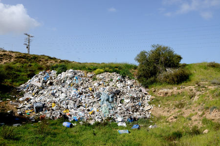 industry moody: debris thrown in a vacant lot near Ashkelon city, Israel