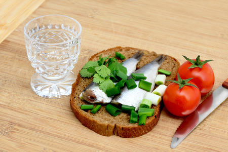 herring and green onion on a bread photo
