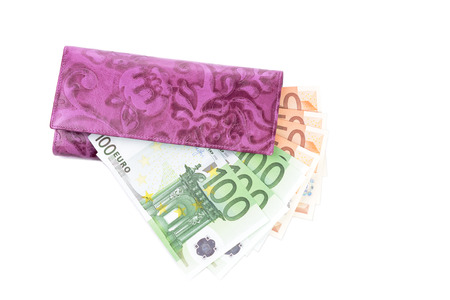one hundred euro banknote: violet  leather  purse and euro  banknotes over white