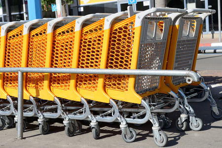 trundle: Row of shopping carts at supermarket entrance