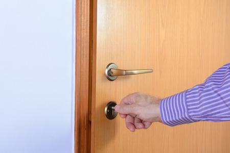 ajar: The person opens an interior door