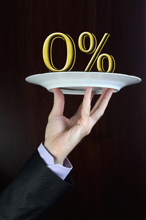 percentage sign: Business man hand holds on a plate zero percentage sign