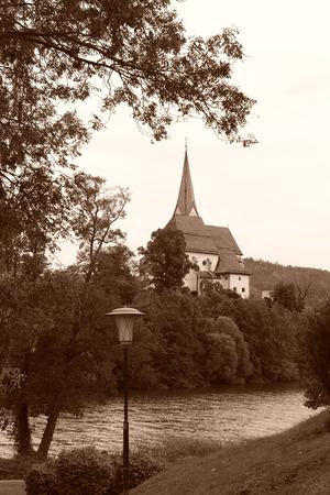 primus: Resort Maria Worth. Church of St. Primus and Felician. Austria. Sepia toned image.