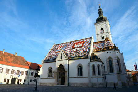 st mark: St. Mark Church and croatian government building. Zagreb. Stock Photo