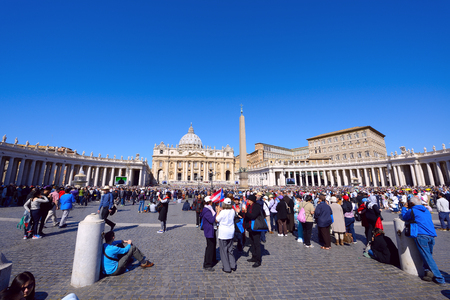 praying together: VATICAN CITY, VATICAN - APRIL 20,2016: Crowds of pilgrims gathered  at Saint Peters Square in Vatican. Thousands of people are praying together with Pope Francis I.