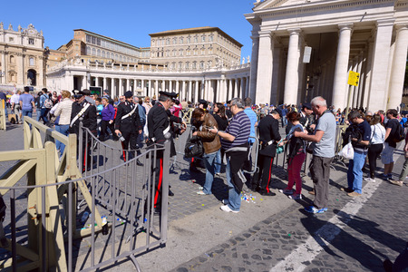gathered: VATICAN CITY, VATICAN - APRIL 20,2016: Crowds of pilgrims gathered  at Saint Peters Square in Vatican. Thousands of people are praying together with Pope Francis I.