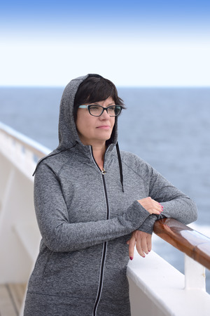 ship deck: Adult woman standing on cruise ship deck