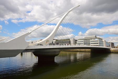 samuel: DUBLIN, IRELAND - JULY 28, 2016: Samuel Beckett Bridge crossing the River Liffey in Dublin, Ireland Editorial