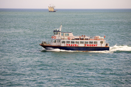 english channel: ENGLISH CHANNEL- JULY 25, 2016: Passenger boat floating by English Channel near St. Peter Port, Guensey. The Herm Trident Ferry sails daily from the St Peter Port Harbour. Editorial