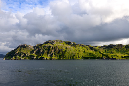 devonian: View of giant sea cliff overlooking the English Channel. Portree, Scotland.