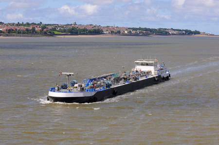 barge: Barge moving in the waterways of Liverpool, United Kingdom. Stock Photo