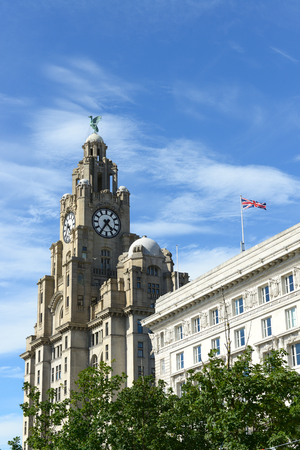 The Royal Liver Building, Liverpool, UK over cloudy sky.