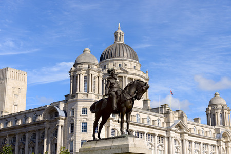 Statue of King Edward VII of Britain outside the Three Graces, buildings on Liverpools waterfront, UK.